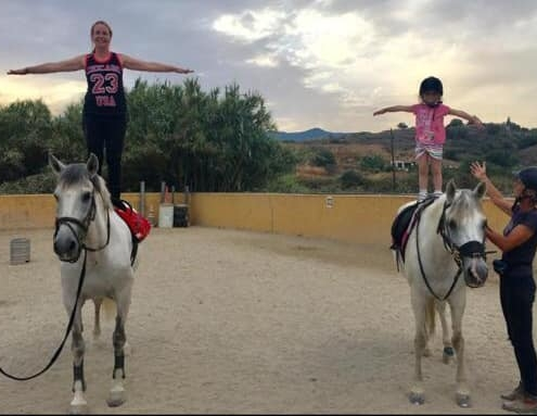 mum and daughter horse riding
